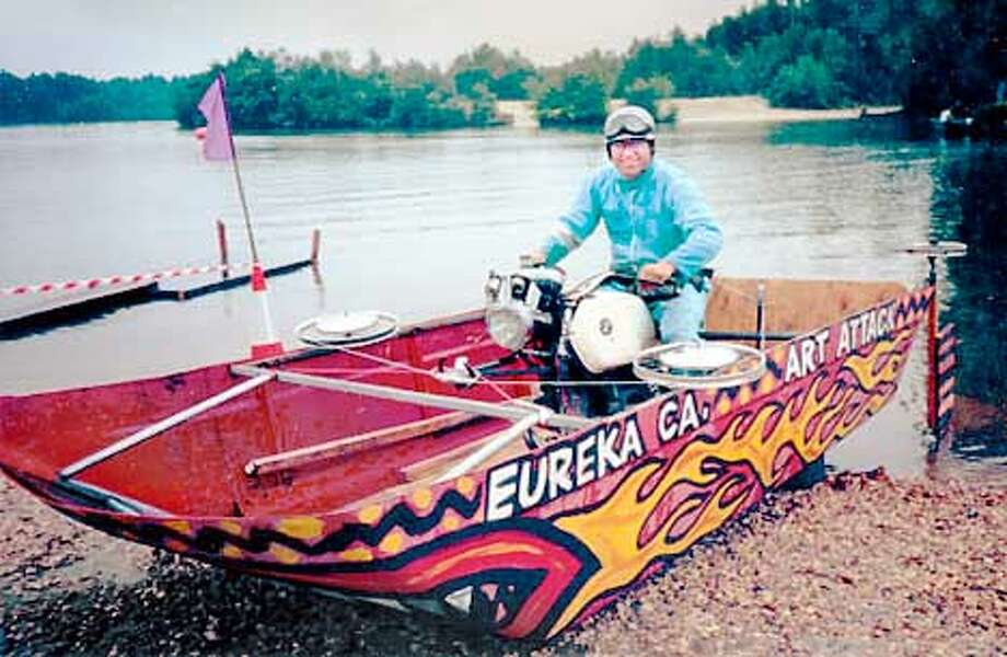 "Duane Flatmo, an artist from Eureka, prepared to take Hot Hazel on her maiden voyage near London. The boat was cobbled together using a motorcycle engine and the roof of a van during a taping of ""Junkyard Wars."" Photo courtesy of Ken Beidleman"