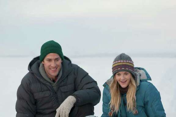 """In this image released by Universal Pictures, John Krasinski, left, and Drew Barrymore are shown in a scene from """"Big Miracle,"""" a film about the rescue of a family of gray whales trapped by rapidly forming ice in the Arctic Circle. The film opens Feb. 3. (AP Photo/Universal Pictures, Darren Michaels)"""