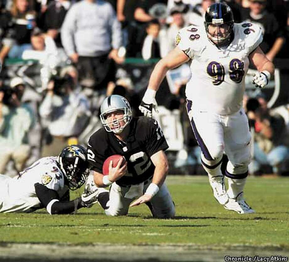 Rich Gannon feels the pressure from the Ravens' defense in the first quarter. The Oakland Raiders and the Baltimore Ravens battle for the AFC Championship on January 14, 2001 in Oakland, California. Lacy Atkins/San Francisco Chronicle Photo: Lacy Atkins