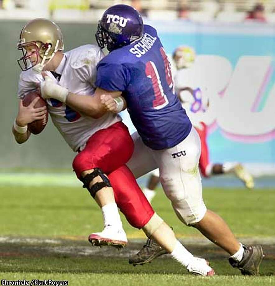 The 76th Annual East West Shrine Game .Aaron Schobel of the west sacks East QB Tim Hasselbeck for a loss in the second qurter .Photo By kurt Rogers Photo: Kurt Rogers