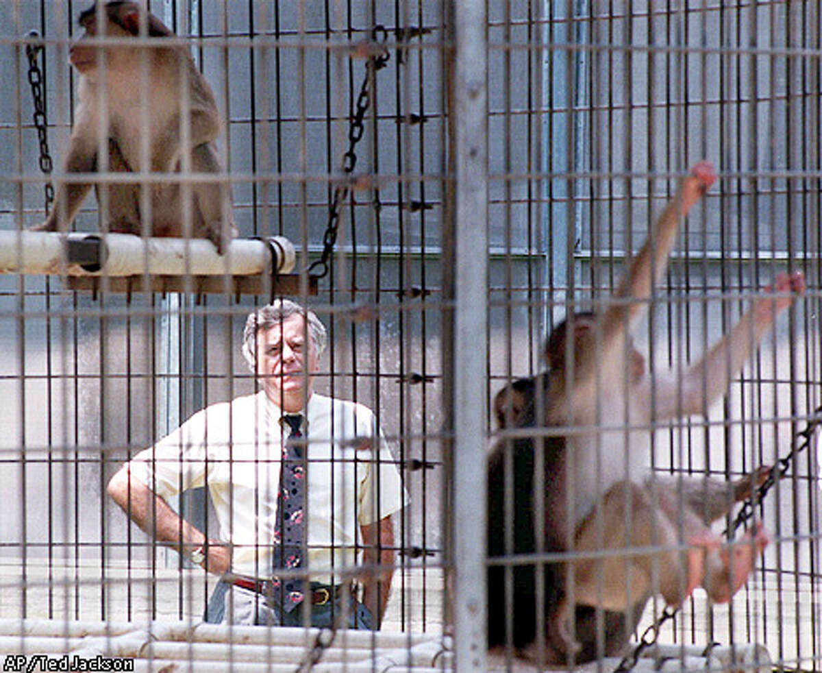 Preston Marx, center, shown on Aug. 26, 1998 photo, is the new director of AIDS research at Tulane University's Primate Center in Covington, La. Marx's work in Africa found a link between simian viruses, a probable forerunner of AIDS, which were spread from monkeys to humans. (AP Photo/The Times-Picayune, Ted Jackson)