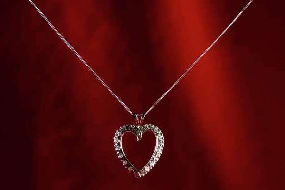 A classic diamond heart 14k white-gold pendant retails for $2800 at Houston Jewelry is shown in the Chronicle studio Thursday, Jan. 26, 2012, in Houston. ( Hallie Jordan / Houston Chronicle )