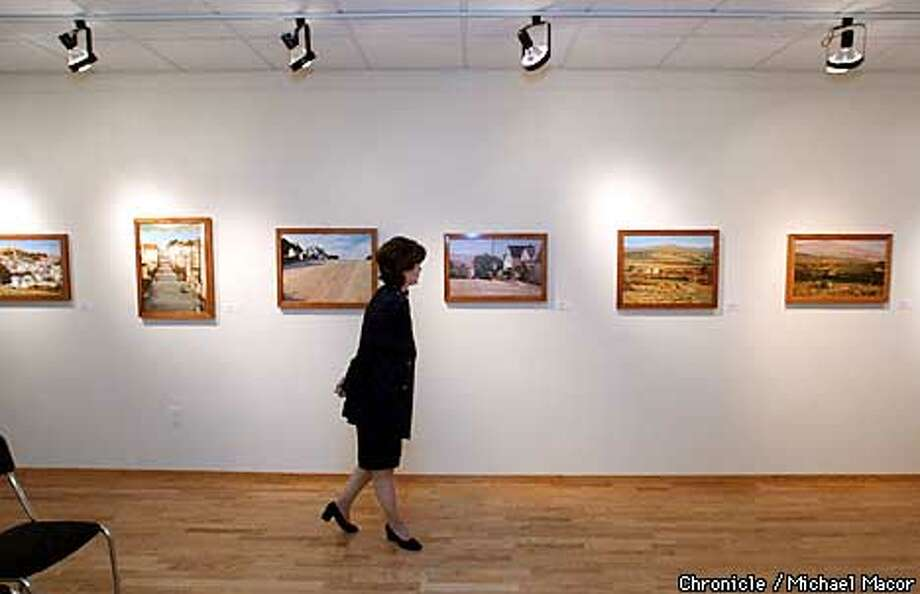 Director of the Italian Cultural Center in SF on Washington St. , Amelia Antonucci walks past an art exhibit by Italian artist Mario Delogu. by Michael Macor/The Chronicle Photo: MICHAEL MACOR