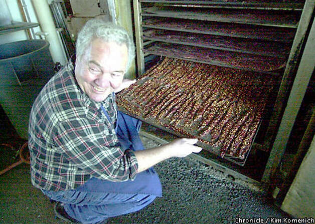 Angelo Ibleto, owner of Angelo's Meats, showed off beef jerky. Chronicle photo by Kim Komenich