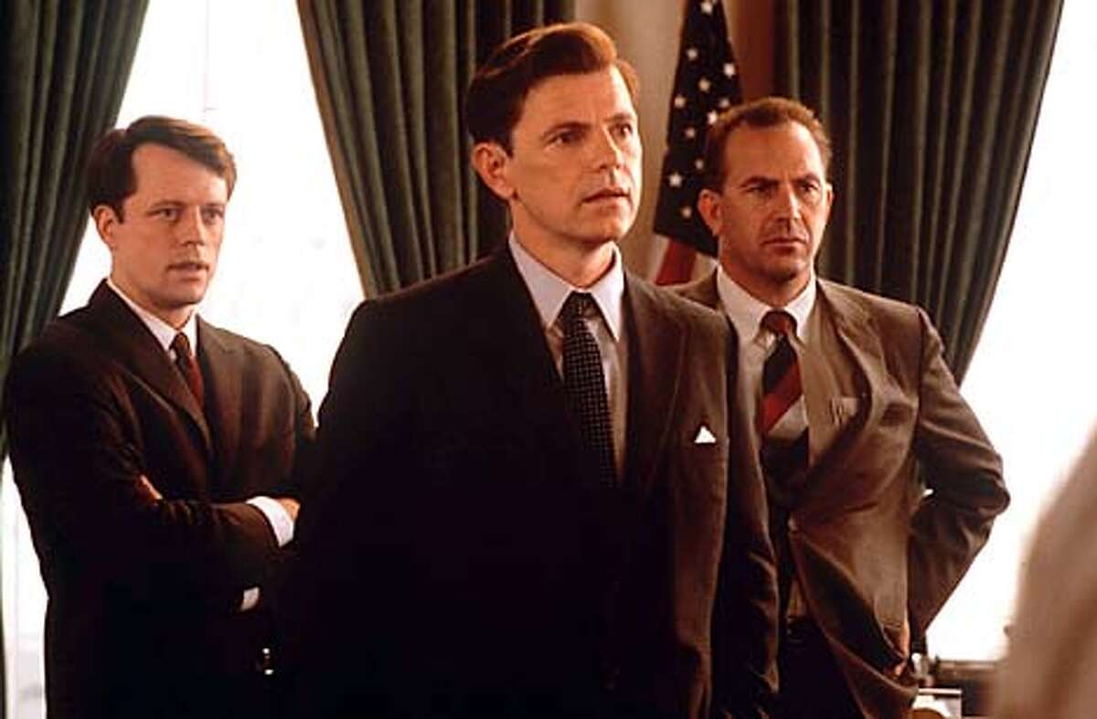 """Steven Culp plays Bobby Kennedy, Bruce Greenwood plays President John Kennedy and Kevin Costner plays special assistant Kenny O'Donnell in """"Thirteen Days."""" Publicity photo"""
