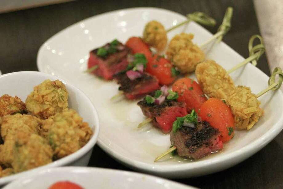 Hit the supermarket and pick up some beef, tomatoes and avocados to make restaurateur Michael Cordúa's recipe for Pinchos de Churrascos, three elements prepared separately and then served on skewers. Photo: Karl Heim