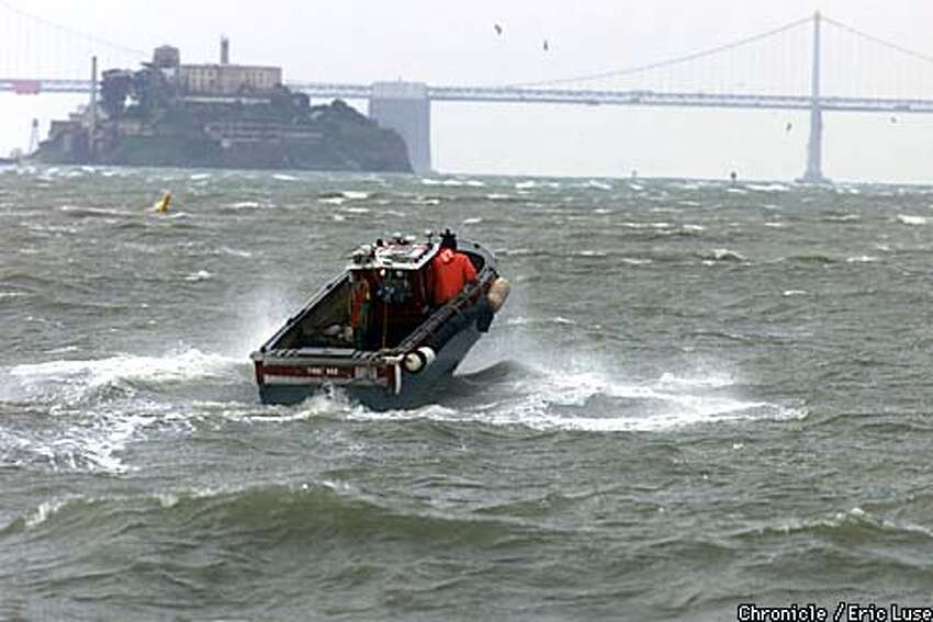 A sailor in a small boat braved the seas as he headed out in heavy winds towrds the San Francisco Bay from Sausalito. Chronicle photo by Eric Luse
