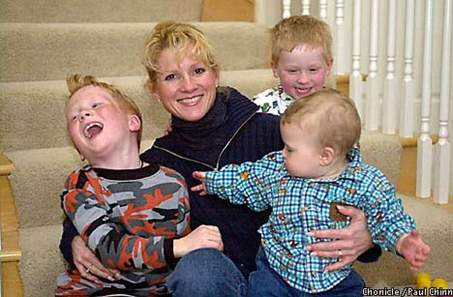 NFL wife Cindy Gruden, with children Deuce (left), Jayson (front right) and Michael  knows how to handle her life. Chronicle photo by Paul Chinn