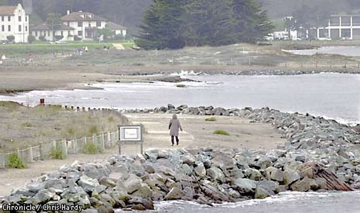 CRISSY10-C-JAN09-SZ-CH Erosion on beach at Crissy field. The beach used to go in a straight line from the rocks at the far right to the rocks in the foreground, but now jogs in about 100 feet -photo by CHRIS HARDY
