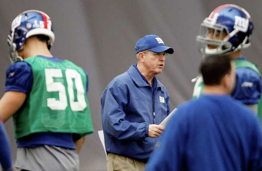 New York Giants head coach Tom Coughlin, center, watches over practice, Thursday, Feb. 2, 2012, in Indianapolis. The Giants will face the New England Patriots in the NFL football Super Bowl XLVI  on Feb. 5. Photo: AP