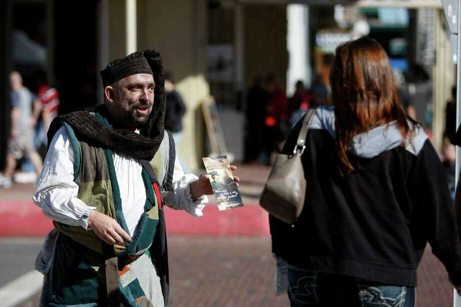 Actor, Chris Clark, aka pirate Sterling, looks for costumers along the Strand for the new Pirates Legends of the Gulf Coast Saturday, Jan. 28, 2012, in Galveston.  Pirate's Legends of the Gulf coast is a new interactive attraction in Galveston's historical district.  The attraction includes actors portraying pirates that interact with guests as well as information about the myths and stories of the buccaneers who pirated goods in the Gulf of Mexico. Much attention is dedicated to the Battle of New Orleans hero, Jean Lafitte, who spent his last documented years on Galveston Island. ( Johnny Hanson / Houston Chronicle ) Photo: Johnny Hanson / © 2012  Houston Chronicle