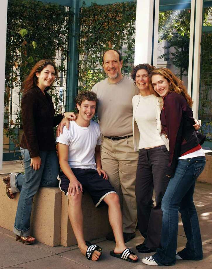 FILE --Mark Zuckerberg, seated, with his parents, Edward and Karen, and sisters Randi, at left, and Arielle, at right.   Among the findings revealed in the company's prospectus for an initial public offering, filed Wednesday, FEb. 1, 2012, is that a number of family members of Facebook executives have benefited handsomely from the social networking giant's success.(Sherry Tesler/The New York Times) Photo: SHERRY TESLER, NYT / NYTNS