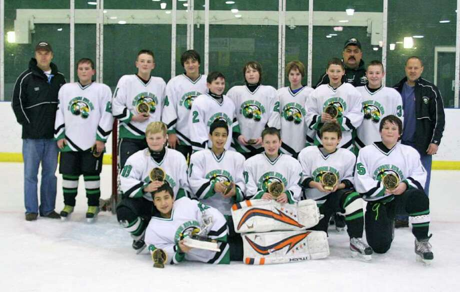 Clifton Park Eagles Pee Wee B team won the Between the Pipes tournament at Clifton Park. Team members are, standing, from left: coach Bruce Davis, Jake Nigriny, Alex Cardinale, Dawson Davis, Kaleb Bogardus, Brendan McCue, Brian Ralph, Philip Santulli, coach Tony Santulli, Zachary Zelker, and coach Tom Rupert. Kneeling: Timothy Hayes, Nicholas Cantali, Nick Popp, Zachary Rupert, and Jack Wroe. Goalkeeper is Luka Newton. Pee Wee level players are 11- and 12-years-old.?