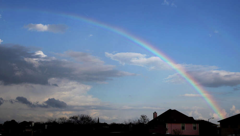 A rainbow arches across the sky in north central San Antonio near McAllister Park Thursday afternoon February 2, 2012. John Davenport/San Antonio Express-News Photo: JOHN DAVENPORT, SAN ANTONIO EXPRESS-NEWS / SAN ANTONIO EXPRESS-NEWS (Photo can be sold to the public)