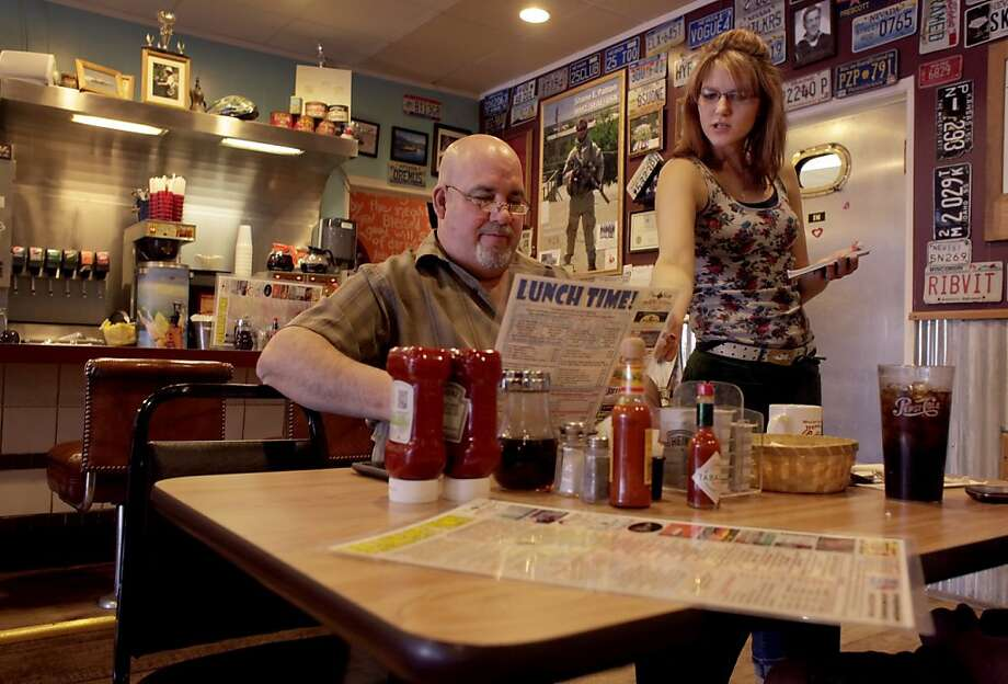 Waitress Timber Hill points out one of the cafes special dishes to Robert Wytoshek, Wednesday February 1, 2012,  at the World Famous Coffee Cup Cafe in the small town of Boulder outside Las Vegas  Nevada. Photo: Lacy Atkins, The Chronicle