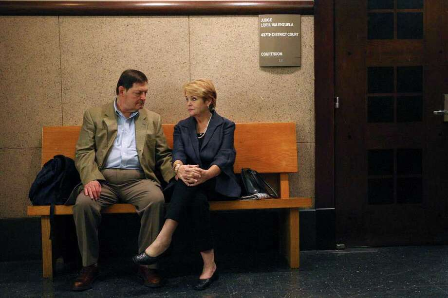 Darrell and Deborah Edwards, the parents of slaying victim Dana Clair Edwards, sit across the hall from the courtroom as they wait to testify in the trial of Jon Thomas Ford on Thursday, Feb. 2, 2012. The couple were not called to testify on the second day of Ford's murder trial. Photo: Jerry Lara, San Antonio Express-News / © San Antonio Express-News