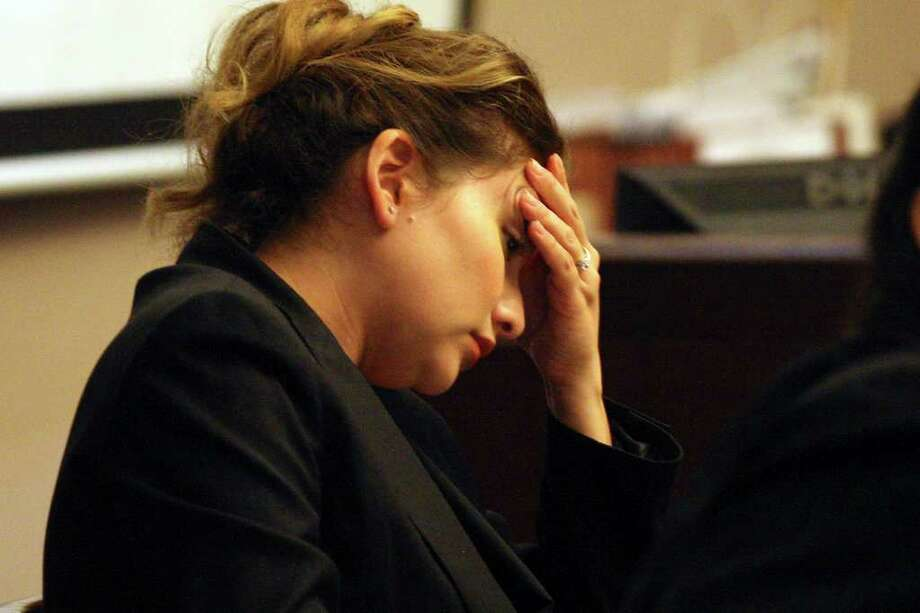 Jenny Ann Ybarra listens to testimony during her intoxication manslaughter and assault trial in the 2007 death of Erica Nicole Smith, a passenger in a car that Ybarra's car slammed into. Photo: Jerry Lara, San Antonio Express-News / © San Antonio Express-News