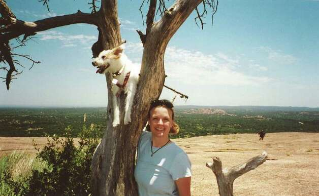 Dana Clair Edwards and her dog Grit in 2007. Prosecutors believe Edwards was killed early New Year's Day 2009. Grit's body was found a week later. Photo: Courtesy Photo