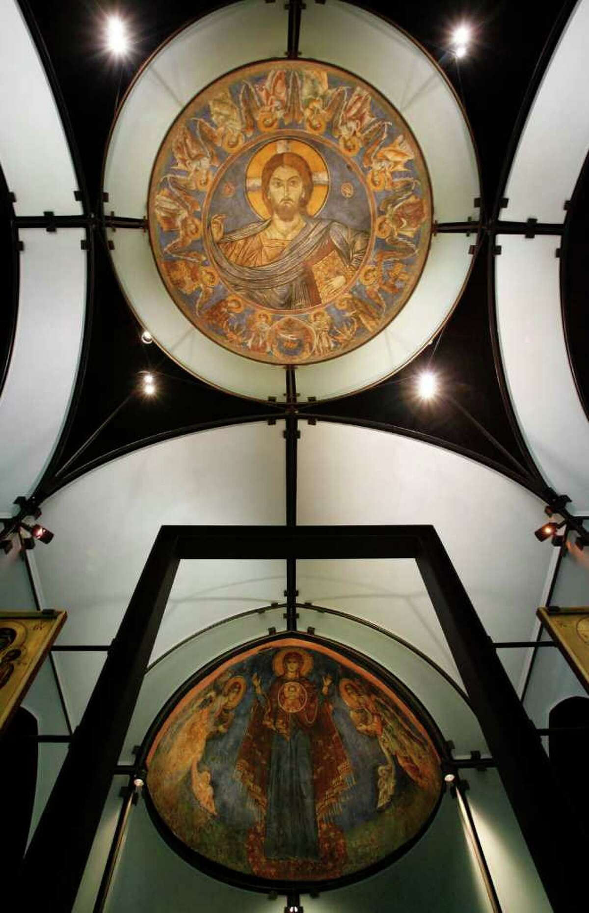 Photo of multi-colored frescos on the dome and sides of the glass walls of the Byzantine Chapel, Thursday, Sept. 27, 2007. The Chapel is the only repository in the United States with intact Byzantine frescoes in the entire western hemisphere. These masterworks from the 13th century -- a dome and an apse -- were ripped and stolen out of a chapel near Lysi in Cyprus in the 1980's, cut into pieces, and smuggled off the island by thieves prepared to sell them piece by piece. The fresco fragments were rescued from the thieves by The Menil Foundation with the knowledge and approval of the Church of Cyprus, the rightful owner of the frescoes. ( Karen Warren / Chronicle)