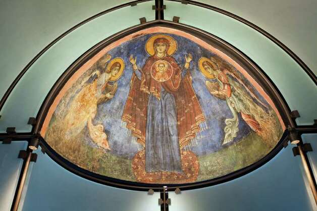 The Byzantine Fresco Chapel includes a fresco of the Virgin, flanked by archangels Gabriel and Michael. Photo: Smiley N. Pool / © 2011 Houston Chronicle