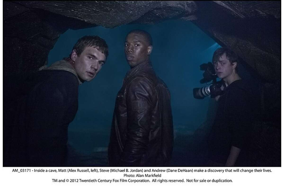 Inside a cave, Matt (Alex Russell, left), Steve (Michael B. Jordan) and Andrew (Dane DeHaan) make a discovery that will change their lives in,
