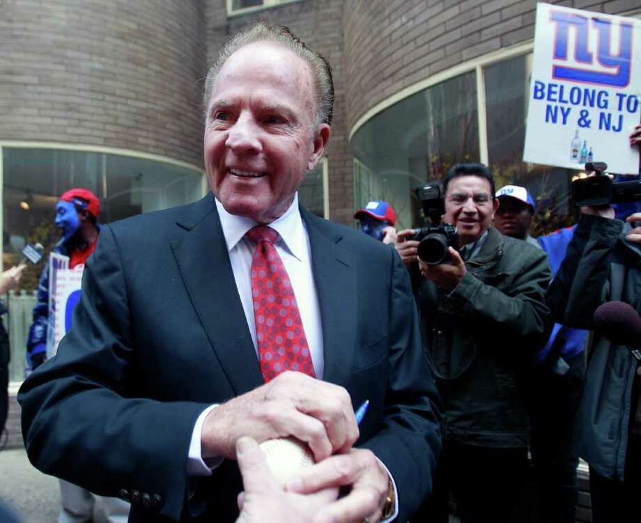 Frank Gifford arrives for a private luncheon rally for the New York Giants NFL football team on Wednesday, Feb. 1, 2012, in New York.  Angry Giants fans protested against being excluded from the major pre-Super Bowl rally and celebration hosted by Giants owner Steve Tisch and A listers. (AP Photo/Frank Franklin II) Photo: Frank Franklin II, Associated Press / AP