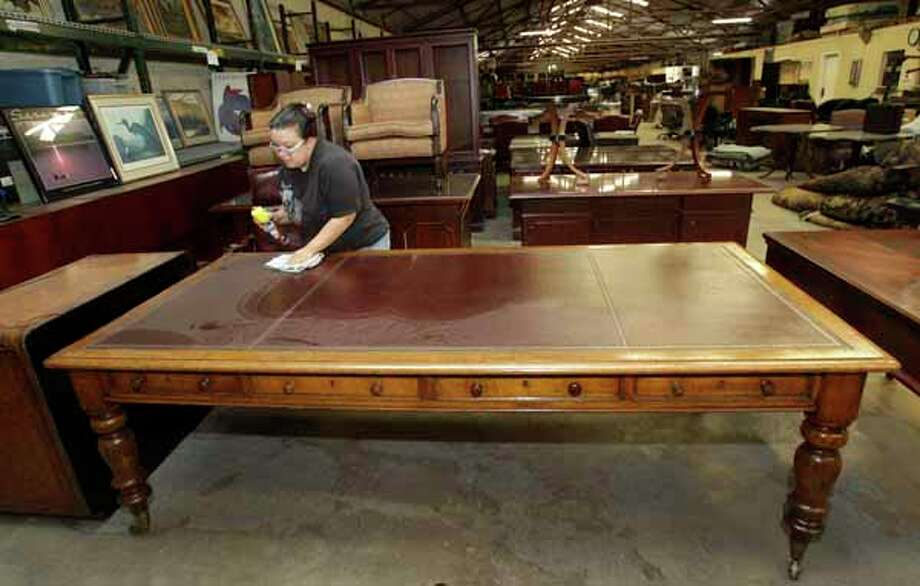 This desk from the 1800s was part of a Stanford auction last year. Photo: Melissa Phillip, Houston Chronicle / © 2010 Houston Chronicle