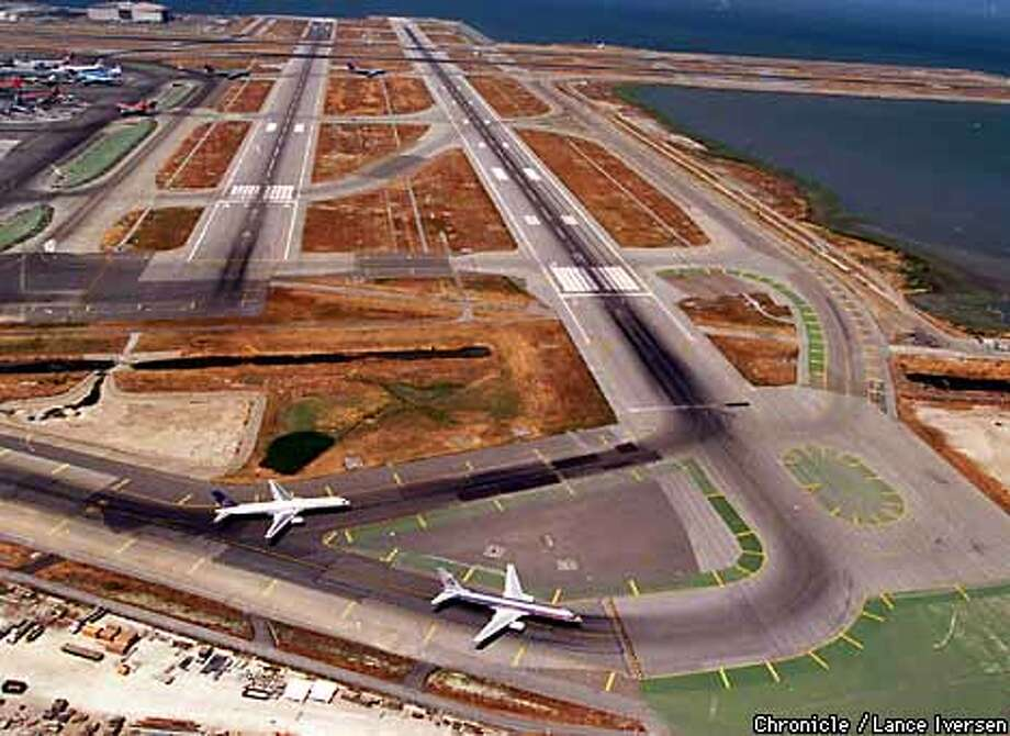 Airliners approached runways at SFO. Chronicle file photo by Lance Iversen, 1999