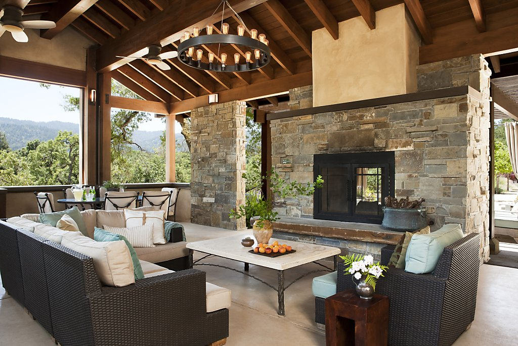 Pool pavilion now a comfortable relaxing shelter sfgate for Indoor and outdoor fireplace design