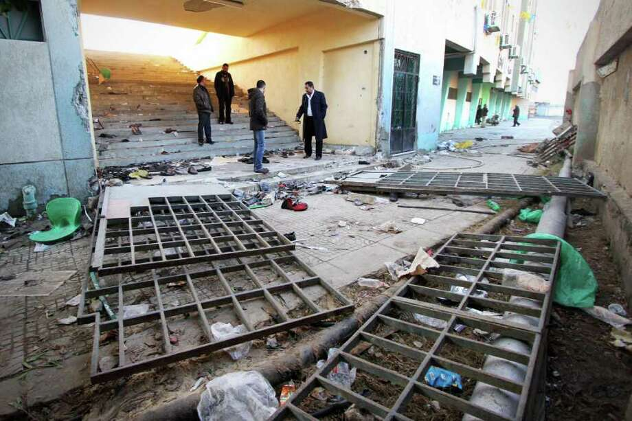 Rubble remains inside a soccer stadium the day after deadly clashes in Port Said, Egypt, left 74 people dead. Many families vented their rage on lack of security at the game and blamed the military for allowing the riot. Photo: STR / AP