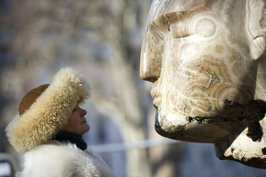 Tete-a-tete: British sculptor Emily Young stares at one of her 