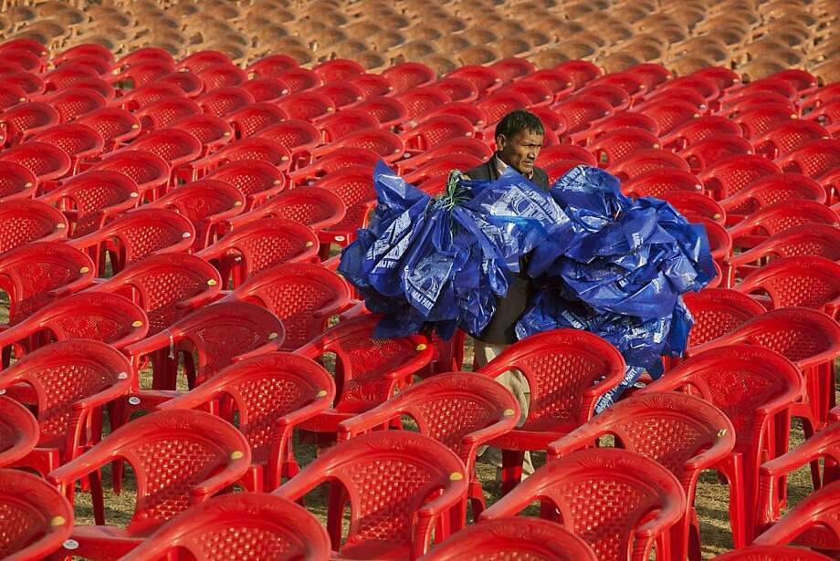 Primary colors: A worker carries Bahujan Samaj Party flags to be flown at the venue of a rally in Faizabad, India, where Mayawati, chief minister of Uttar Pradesh state, will speak. Uttar Pradesh will be choosing its state assembly in elections starting next week.  