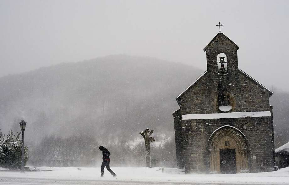 A man walks as snow and frozen wind billows cross the region, in Roncesvalles, northern Spain, Thursday Feb. 2, 2012. A cold spell has reached Europe with temperatures plummeting far below zero.  (AP Photo/ Alvaro Barrientos) Photo: Alvaro Barrientos, Associated Press