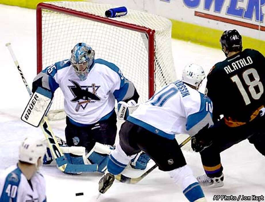 San Jose Sharks goalie Evgeni Nabokov (35) stops the puck during the first period against the Phoenix Coyotes, Monday, Jan. 1, 2001, in Phoenix. Sharks' Marcus Ragnarsson (10) defends against Coyotes' Mika Alatalo (18) on the play. (AP Photo/Jon Hayt) Photo: JON HAYT