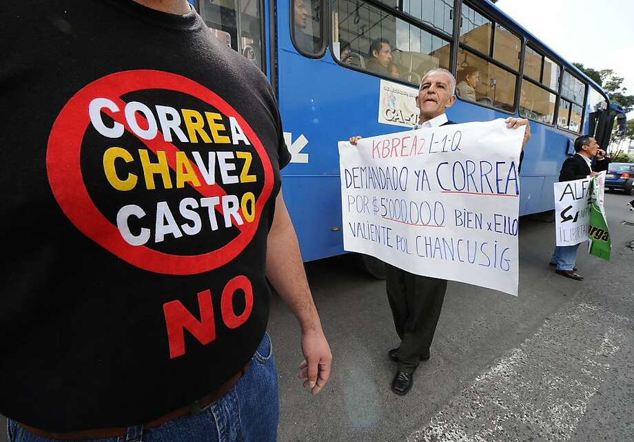 "Opponents to Ecuadorean President Rafael Correa shout slogans outside the National Court of Justice (CNJ) in Quito, on January 24, 2012, after the cassation appeal  in the trial against El Universo newspaper was suspended. Correa had sued the El Universo newspaper for $80 million in March 2011, alleging ""defamatory libel"" over a column by former opinion page editor Emilio Palacio accusing the president of crimes against humanity.  AFP PHOTO / RODRIGO BUENDIA (Photo credit should read RODRIGO BUENDIA/AFP/Getty Images) Photo: Rodrigo Buendia, AFP/Getty Images"