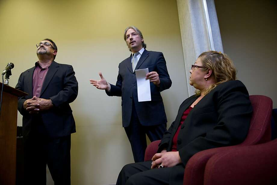 Javier Tenorio (L) and Mariette Tenorio (R) listen as city attorney Matt Gonzalez (C) speaks during a press conference at the Public Defenders office in San Francisco, Calif.   Photograph by David Paul Morris/Special to the Chronicle Photo: David Paul Morris, Special To The Chronicle