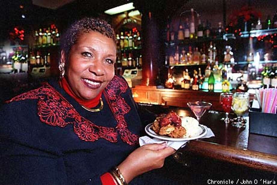 Oakland, CA. Geoffrey's Inner Circle, 410 -14th st.  Happy hour buffet 5:30 -8:30 Wed. -Friday.  Mary King Alameda Co. Supervisor with a plate of chicken Etc.  Photo by.........John O'Hara Photo: John O'Hara