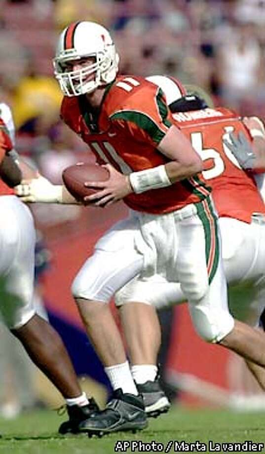 Miami quarterback Ken Dorsey (11) drops back in the pocket against Pittsburgh Saturday, Nov. 11, 2000. Dorsey threw two touchdown passes and ran for another score as No. 2 Miami overcame a slow start to beat Pittsburgh 35-7. (AP Photo/Marta Lavandier) Photo: MARTA LAVANDIER