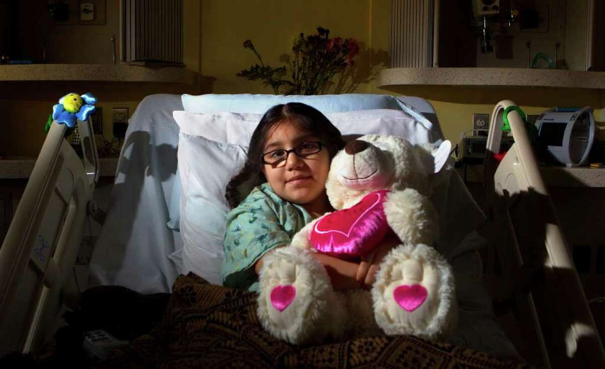 Alyssa Rosas, 8, at Texas Children's Hospital, still has an open wound from an attack by the family dog.