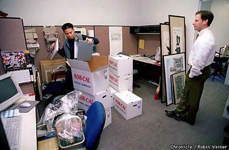 Danilo Cuevas, a legislative aide to Supervisor Mabel Teng, packs up her office while Matthew Lonner, right, also an aide, looks on for the move back to City Hall from the Veterans War Memorial Building across the street.  BY ROBIN WEINER/THE CHRONICLE Photo: ROBIN WEINER