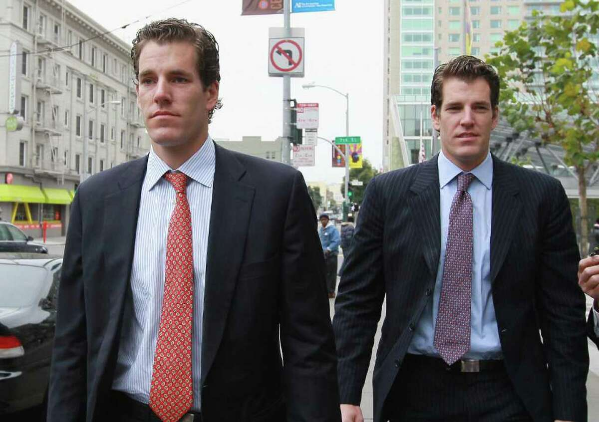 Greenwich natives Cameron, left, and Tyler Winklevoss leave the U.S. Court of Appeals on Jan. 11, 2011, in San Francisco.