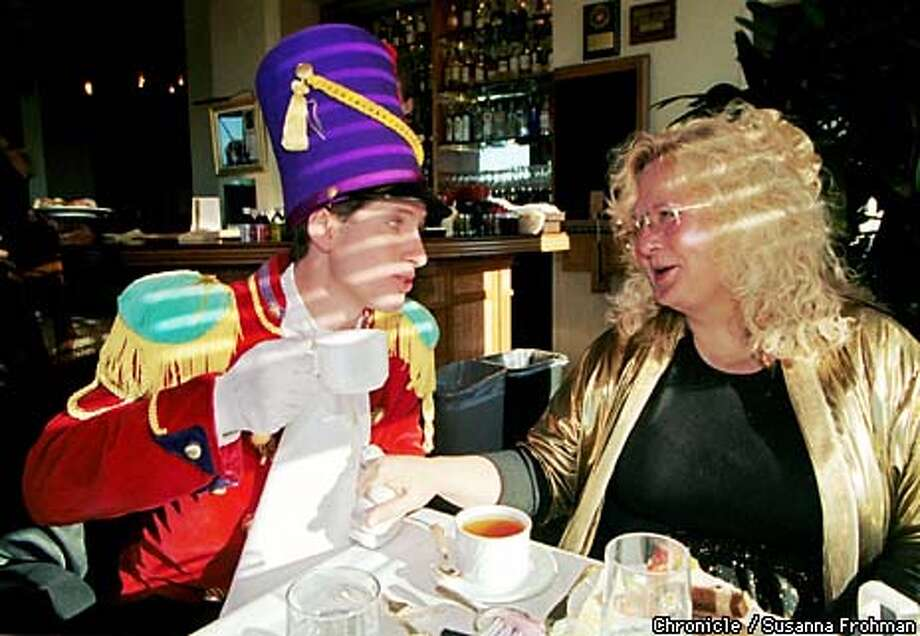 Toy soldier Frank Varni surprises Top of the Mark patron Hannah Stevenson with an inpromptu visit to her table during Holiday Tea at the Mark Hopkins hotel in San Francisco. (CHRONICLE PHOTO BY SUSANNA FROHMAN) Photo: SUSANNA FROHMAN