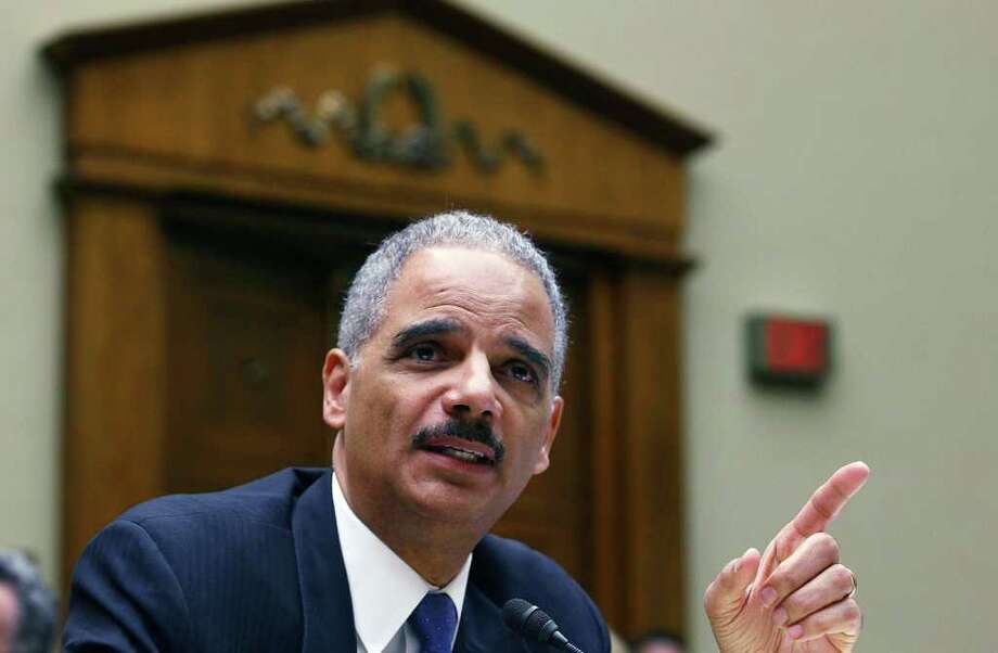 Attorney General Eric Holder testifies during a House Oversight and Government Reform Committee hearing on the Fast and Furious gun-tracking operation. Photo: Mark Wilson, Getty Images / 2012 Getty Images