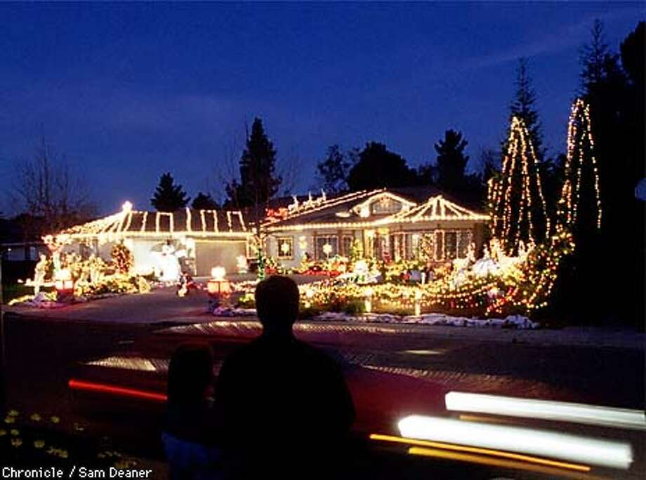 - - Elaine Donnelly's home on Flowerwood Place in Walnut Creek is attracting a lot of traffic this season as more than 30,000 lights adorn the abode in the spirit of Christmas in the theme of a winter wonderland. (CHRONICLE PHOTO SAM DEANER) Photo: SAM DEANER