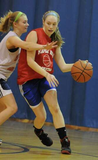 Maple Hill basketball player Lindsay Mannion dribbles the ball as she practices with her team on Thu