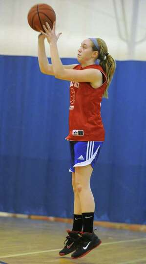 Maple Hill basketball player Lindsay Mannion shoots s the ball as she practices with her team on Thu