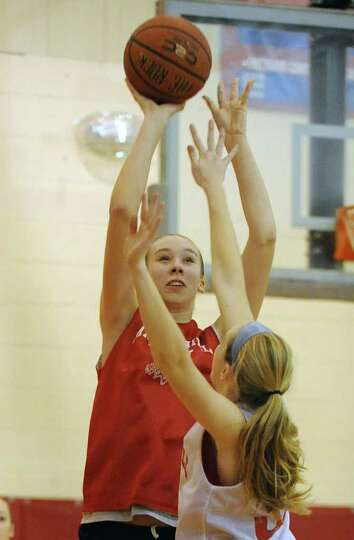 Maple Hill basketball player Siobhan Sorensen shoots the ball as she practices with her team on Thur