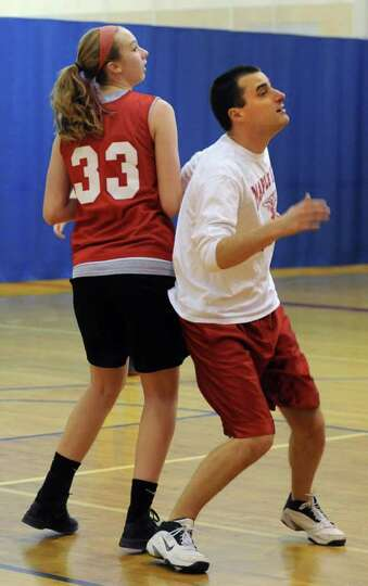 Maple Hill basketball player Siobhan Sorensen and coach Mark Bubniak try to box each other out durin