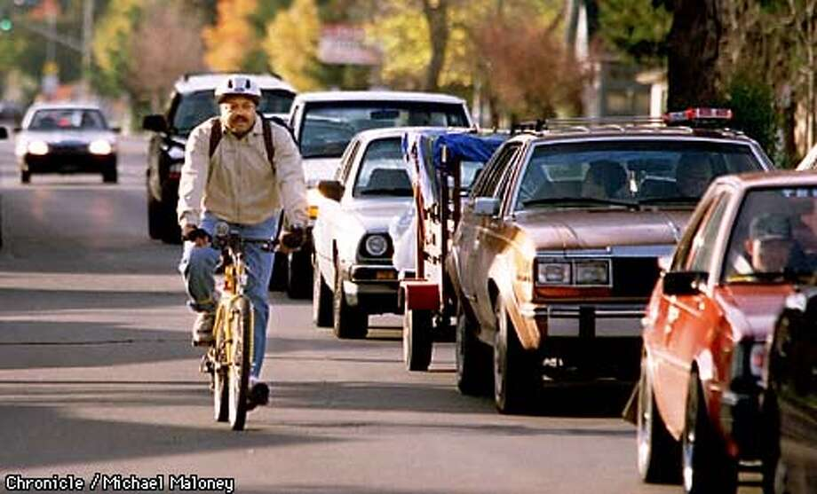 Michael E. Jackson pedals to work down busy Alhambra Valley Blvd in Martinez.  Jackson is the Contra Costa County bicycle facilities coordinator and often bikes to work.  BY MICHAEL MALONEY/THE CHRONICLE Photo: MICHAEL MALONEY