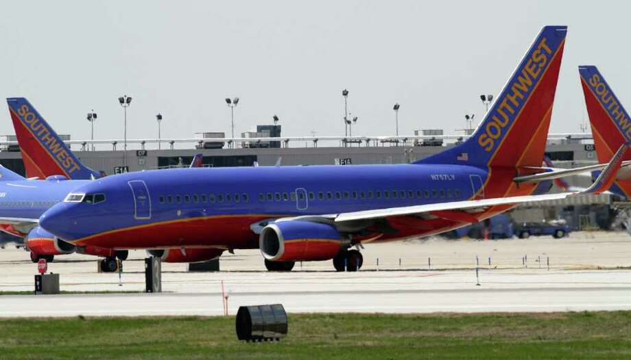 FILE - In this April 6, 2011 file photo, a Southwest Airlines aircraft taxies at Philadelphia International Airport, in Philadelphia. Southwest Airlines is making money Thursday, Jan. 19, 2012, even with higher fuel prices, thanks to full planes and rising fares. (AP Photo/ Joseph Kaczmarek, File) Photo: Joseph Kaczmarek / AP2011